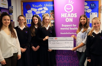 Davison CE High School girls presenting a £500 cheque to Heads On