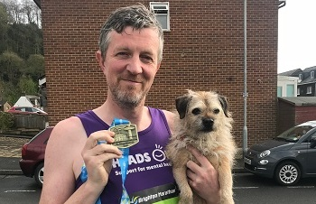 Marathon runner smashes target for dementia services